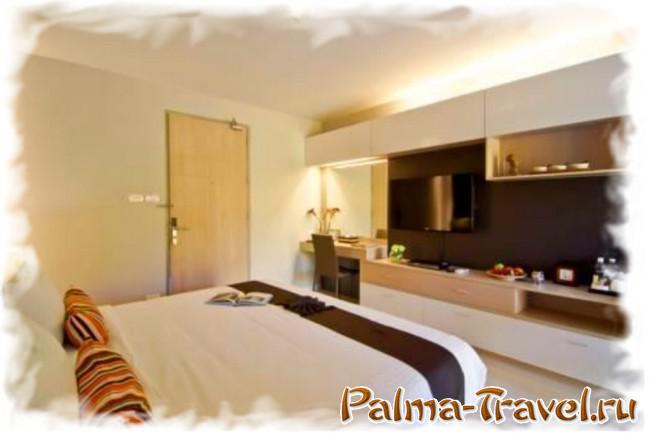 Отель At Mind Executive Suites - кровать в номере