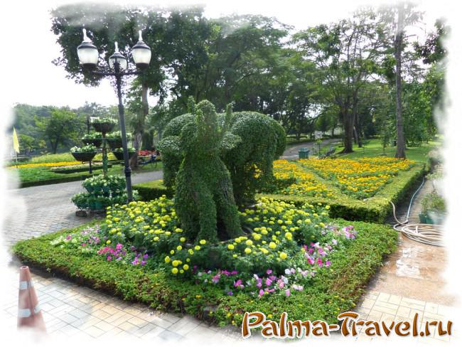Flower beds and green figures in Queen Sirikit Park